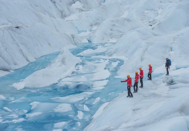 trekkers on a glacier