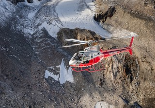 Photo of Denali Tundra Express with Landing Flying over the valley