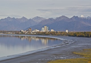 Photo of anchorage from a distance with mtn ranges