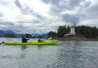 Photo of sitka kayakers near lighthouse