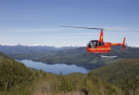 Photo of helicopter flying over mountain lakes