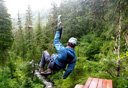Photo of man on alpine zipline