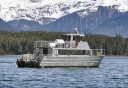 Photo of newest juneau whale watching boat with mountains in background