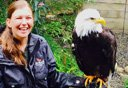 Photo of woman with bald eagle