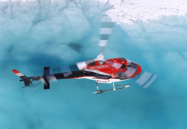 Photo of FLIGHT OVER BLUE GLACIAL POOL
