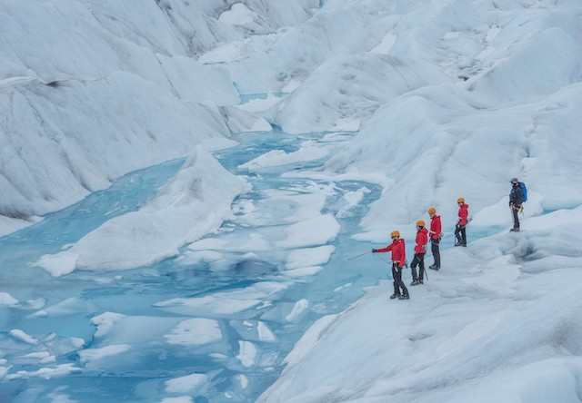 Photo of Juneau Helicopter Glacier Trek Pointing out a Crevase