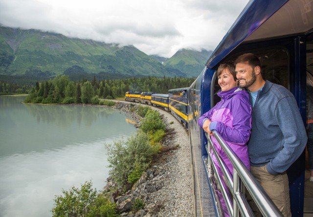 couple enjoys views from train