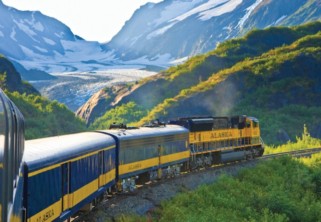 train glides between mountains