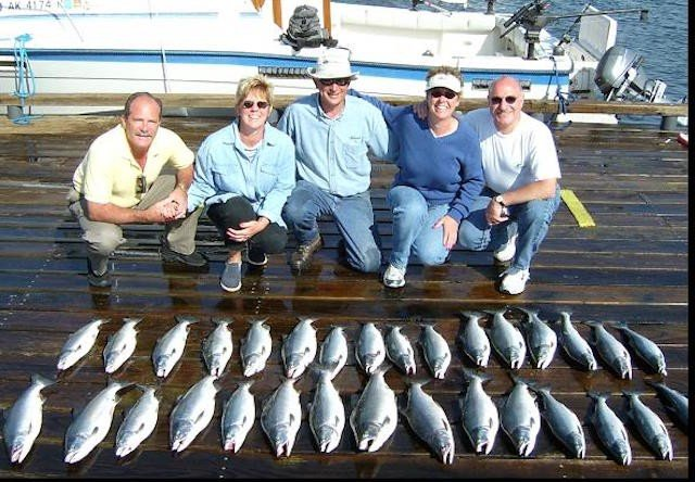 Photo of group displaying catch of the day