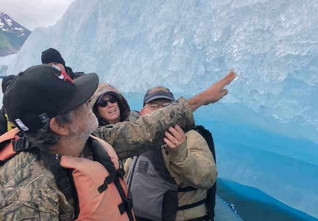 Photo of guest touching iceberg on tour